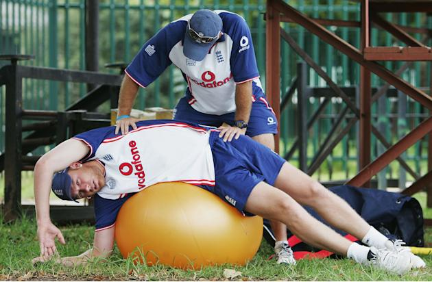 JONANNESBURG - JANUARY 11:  Andrew Flintoff of England has his side strain treated by physio Kirk Russell during a practice session at the Wanderers Cricket Ground on January 11, 2005 in Johannesburg,