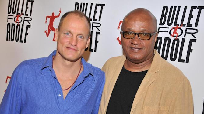 """FILE - This July 9, 2012 file photo originally released by the O and M Co. shows Woody Harrelson, left, and Frankie Hyman pose at the """"Bullet for Proof"""" media availability in New York. The play, co-written by Harrelson and Hyman, is performing off-Broadway at New World Stages. Harrelson's play """"Bullet for Adolf"""" is extending its off-Broadway run and the actor-turned-playwright is hopeful it may even be able to turn a profit.  The comedy was written by Harrelson and friend Frankie Hyman and has a semi-autobiographical plot that sprang from true events and unusual people the pair encountered while youthful construction workers in the summer of 1983. The eight-person play, directed by Harrelson, opened in August at New WorldStages and was originally scheduled to play its final performance on Sept. 9. The production will now play through Oct. 21.  (AP Photo/The O and M Co., Jenny Anderson)"""