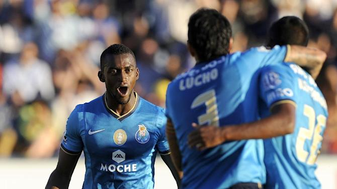 FC Porto's Jackson Martinez, left, celebrates after scoring the opening goal against Arouca during their Portuguese League soccer match at the Municipal Stadium, in Arouca, Portugal, Sunday Oct. 6, 2013