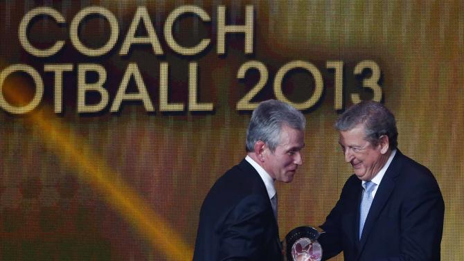 Former Bayern Munich coach Jupp Heynckes receives the FIFA Coach of the Year award from England manager Roy Hodgson at the FIFA Ballon d'Or soccer awards ceremony in Zurich