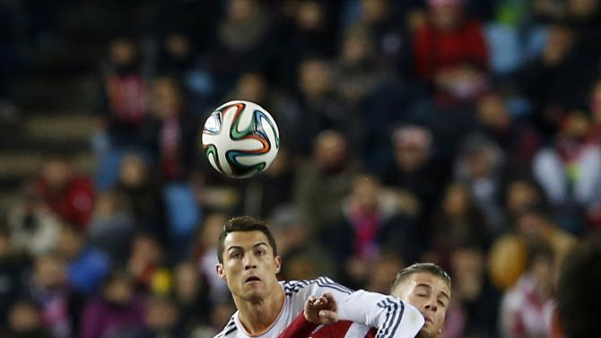 Atletico Madrid's Alderweireld fights for the ball with Real Madrid's Ronaldo during their Spanish King's Cup semi-final second leg soccer match in Madrid