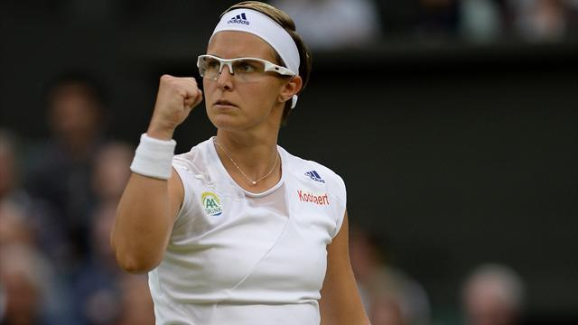 Tennis - Flipkens defies doctor's orders to light up Wimbledon