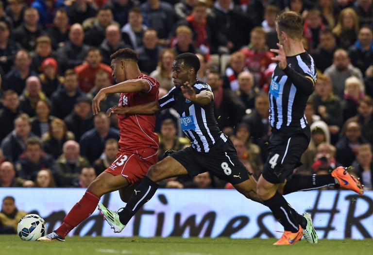 Liverpool's Jordon Ibe (L) fights for the ball with Newcastle United's Vurnon Anita during their English Premier League match, at Anfield in Liverpool, north-west England, on April 13, 2015