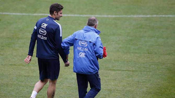France's soccer head coach Didier Deschamps, right, speaks with France's forward Olivier Giroud during a training session at the eve of their 2014 World Cup Group I qualifying soccer match between France and Finland at the Stade de France stadium in Saint Denis, north of Paris, France, Monday, Oct. 14,2013