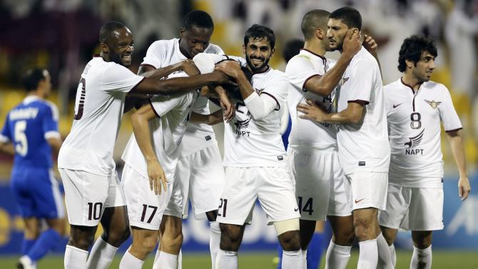 Qatar ElJaish's players celebrate a goal by Ko against Nasaf of Uzbekistan during their AFC Championship League match in Doha