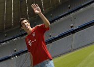 Spanish midfielder Javier Martinez poses at the Allianz Arena stadium in Munich, southern Germany. Martinez said he has signed for Bayern Munich to win titles as he looks forward to making his Champions League debut with the Bavarians