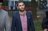 Charles Shrem, the top executive of a New York City-based Bitcoin company, walks from the federal court house in New York Thursday, Sept. 4, 2014, after pleading guilty to federal charges that he helped smooth the way for drug transactions on the online marketplace Silk Road. (AP Photo/Craig Ruttle)