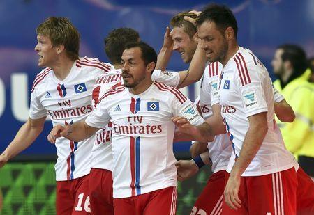 Hamburg SV's Rajkovic is congratulated by teammates after scoring a goal against Schalke 04 during their German Bundesliga first division soccer match in Hamburg