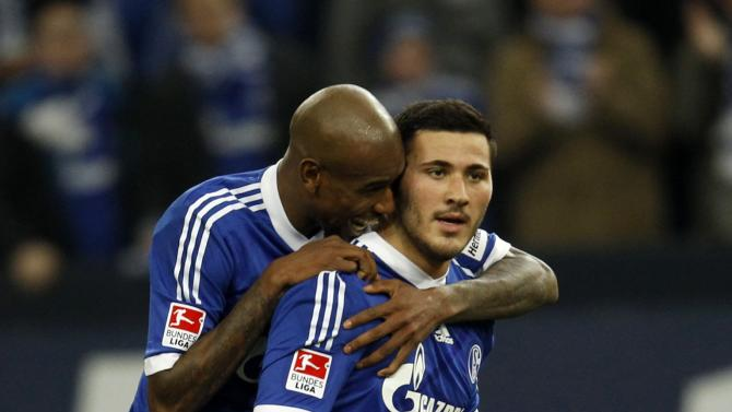 Schalke 04's Santana and Kolasinac celebrate a goal against Hanover during the German first division Bundesliga soccer match in Gelsenkirchen