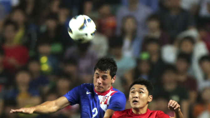 Croatia's Igor Bubnjic, left, fights for the ball against South Korea's Cho Dong-geon during their friendly soccer match at Jeonju World Cup stadium in Jeonju, south of Seoul, South Korea, Tuesday, Sept. 10, 2013. Croatia won the match 2-1