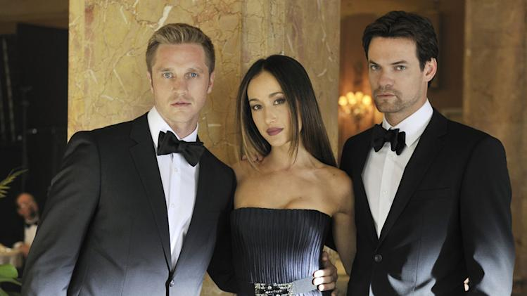 "Devon Sawa as Owen, Maggie Q as Nikita and Shane West as Michael in ""Nikita."""