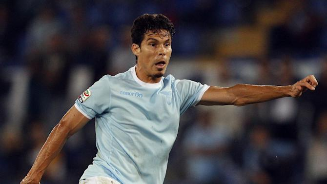 Lazio midfielder Hernanes, of Brazil, kicks the ball during a Serie A soccer match between Lazio and Fiorentina, at Rome's Olympic stadium, Sunday, Oct. 6, 2013