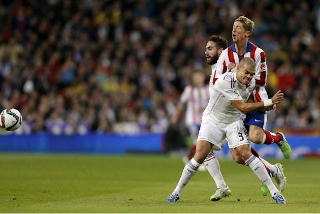 Real Madrid Real Madrid's Pepe from Brazil, foreground, duels for the ball with Atletico de Madrid Fernando Torres during a King's Cup soccer match between Atletico de Madrid and Real Madrid, at the S