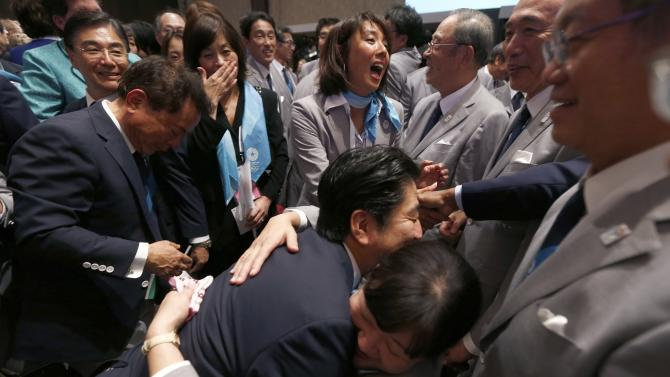 Prime Minister Shinzo Abe of Japan celebrates with members of the Tokyo bid committee after Jacques Rogge, president of the International Olympic Committee, announced Tokyo as the city to host the 2020 Summer Olympic Games in Buenos Aires