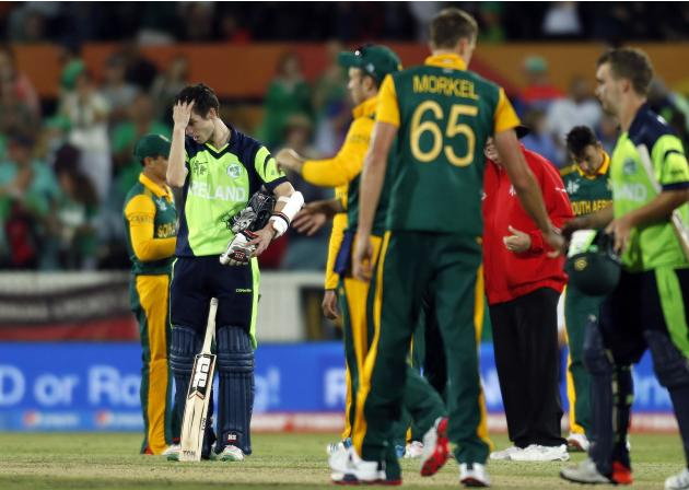 Ireland's George Dockrell reacts after being bowled for 25 runs by South Africa's Morne Morkel to end their Cricket World Cup match at Manuka Oval in Canberra