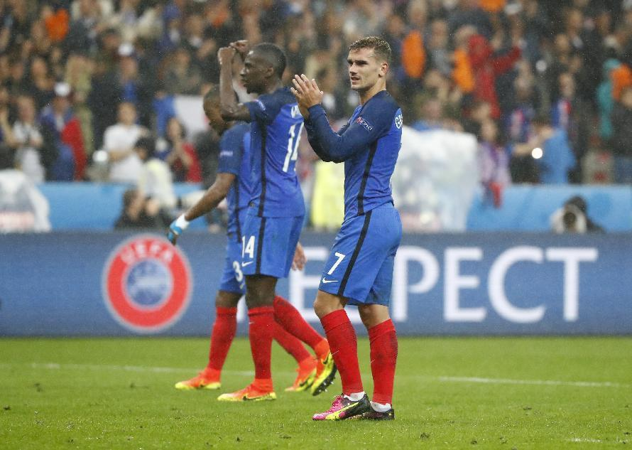 France's Antoine Griezmann applauds the fans at the end of the game