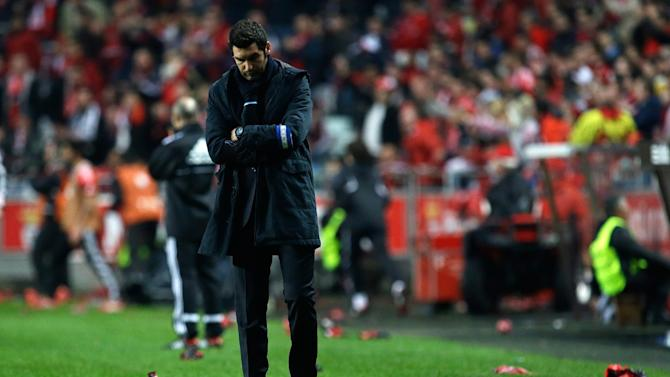 Porto's coach Paulo Fonseca walks on the sideline during their Portuguese league soccer match with Benfica Sunday, Jan. 12 2014, at Benfica's Luz stadium in Lisbon. Benfica defeated Porto 2-0 to take the lead of the championship