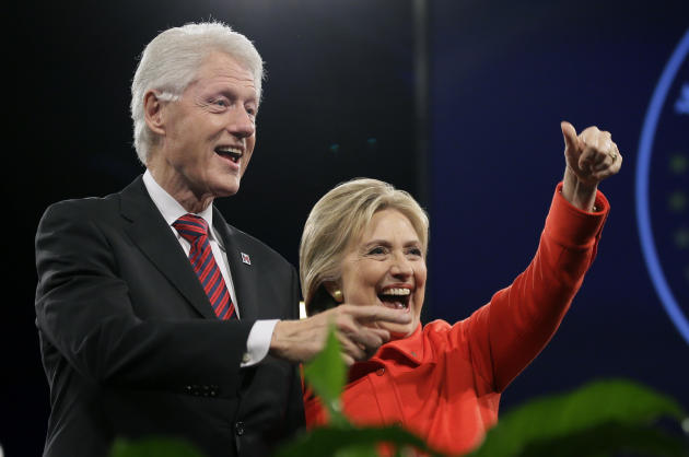 FILE - In this Oct. 24, 2015 file photo, former President Bill Clinton and his wife, Democratic presidential candidate Hillary Rodham Clinton, wave to supporters after the Iowa Democratic Party's