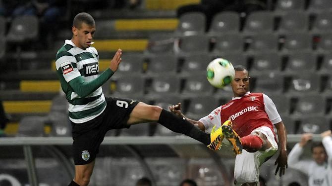 Sporting's Islam Slimani, left, from Algeria, challenges Sporting Braga's Wanderson Baiano, from Brazil, during their Portuguese League soccer match at the Municipal Stadium, in Braga, Portugal, Saturday Sept. 26, 2013. Sporting won 2-1
