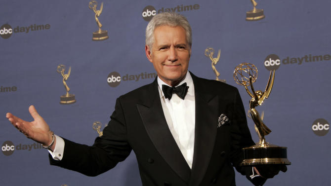 """FILE- In this Friday, April 28, 2006, file photo, Alex Trebek holds the award for outstanding game show host, for his work on """"Jeopardy!"""" backstage at the 33rd Annual Daytime Emmy Awards in Los Angeles. Sony Television spokeswoman Paula Askanas said Sunday, June 24, 2012, that Trebek is in a Los Angeles hospital recovering from a mild heart attack. (AP Photo/Reed Saxon, File)"""
