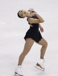 Mirai Nagasu competes during the women's free skate at the U.S. Figure Skating Championships in Boston, Saturday, Jan. 11, 2014. (AP Photo/Elise Amendola)