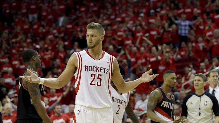 Houston Rockets' Chandler Parsons (25) reacts after Portland Trail Blazers' Robin Lopez hit him on the shoulder after fouling out during overtime in Game 1 of an opening-round NBA basketball playoff series Sunday, April 20, 2014, in Houston. The Trail Blazers won 122-120 in overtime