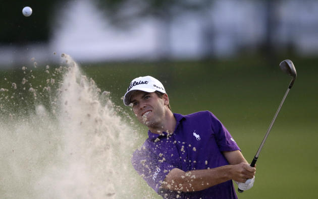 Ben Martin hits out of the sand onto the 18th green during the opening round of the PGA Zurich Classic golf tournament at TPC Louisiana in Avondale, La., Thursday, April 24, 2014. He finished the day
