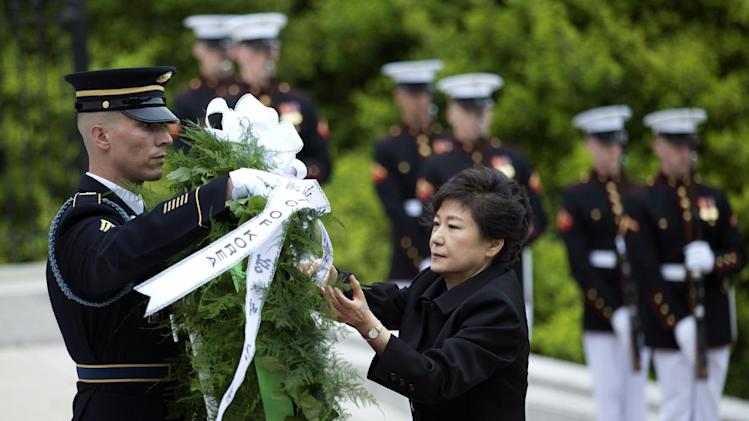 Visiting South Korea President Park Geun-hye, lays a wreath at the Tomb of the Unknowns at Arlington National Cemetery in Arlington, Va., Monday, May 6, 2013.  (AP Photo/Manuel Balce Ceneta)