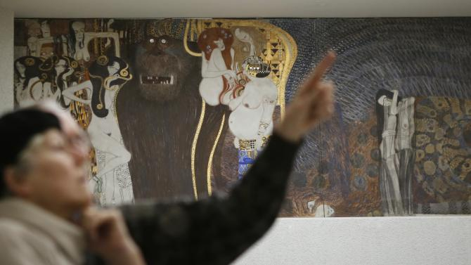Visitors look at  Gustav Klimt's Beethoven Frieze at the Secession museum in Vienna