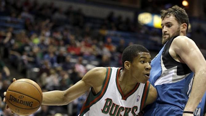 Milwaukee Bucks' Giannis Antetokounmpo (34) drives against Minnesota Timberwolves' Kevin Love, right, during the second half of an NBA basketball game Saturday, Dec. 28, 2013, in Milwaukee