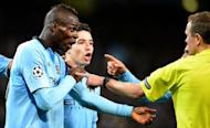 Mario Balotelli (keft) confronts the referee during the Champions League match between Manchester City and Ajax at The Etihad Stadium last week. Italy coach Cesare Prandelli could help Balotelli get over his Manchester City blues by starting the striker in a new two-man attack when the Azzurri host France in a friendly in Parma on Wednesday
