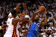 Oklahoma City Thunder's Kevin Durant attempts a shot as Miami Heat's Chris Bosh (L) defends during game four of their 2012 NBA Finals on June 19. Durant had 28 points for the Thunder