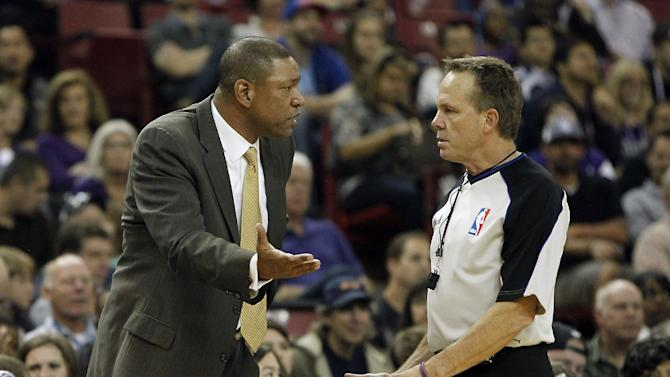 Los Angeles Clippers head coach Doc Rivers questions Official Bill Spooner  about a call during the  third quarter against the Sacramento Kings in a NBA preseason basketball game in Sacramento, Calif., Monday, Oct. 14, 2013.   The Kings won 99-88