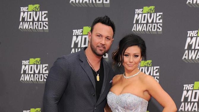 "Roger Matthews, left, and Jenni ""Jwoww"" Farley arrives at the MTV Movie Awards in Sony Pictures Studio Lot in Culver City, Calif., on Sunday April 14, 2013. (Photo by Jordan Strauss/Invision/AP)"