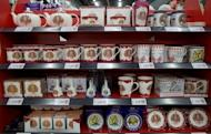 "Souvenirs commemorating Queen Elizabeth II's diamond jubilee are displayed in a London shop. ""We sell an enormous amount from our online shop to customers from North America and the Commonwealth countries,"" a retailer said"