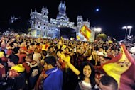Supporters of Spain's national football team celebrate in central Madrid late on July 1 after their team beat Italy 4-0 in the Euro 2012 football championships final in Kiev. A red-and-yellow sea of delirious fans swamped central Madrid in a wild all-night party before hailing the return on Monday of their conquering Euro 2012 heroes