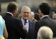 Former U.S. Secretary of Defense Donald Rumsfeld (C) talks to Speaker of the House John Boehner (L) and House Majority Leader Eric Cantor (R) as they gather for ceremonies marking the 10th anniversary of the 9/11 attack on the Pentagon, in Washington September 11, 2011. REUTERS/Molly Riley