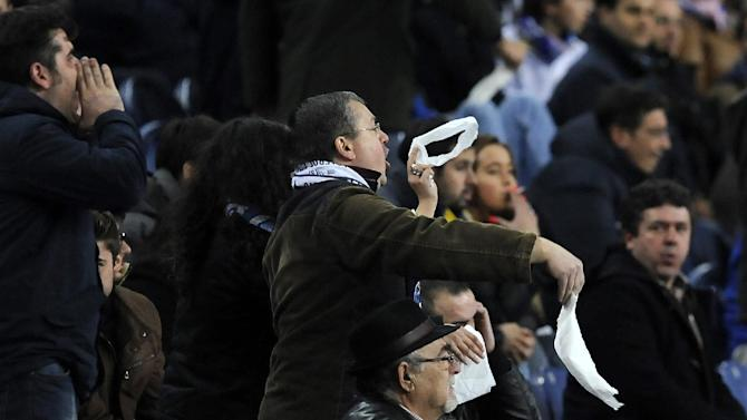 FC Porto's fans shout and wave white handkerchiefs against  coach Paulo Fonseca, not pictured, in a Portuguese League soccer match with Estoril at the Dragao stadium, in Porto, Portugal, Sunday, Feb. 23, 2014. Porto lost 1-0