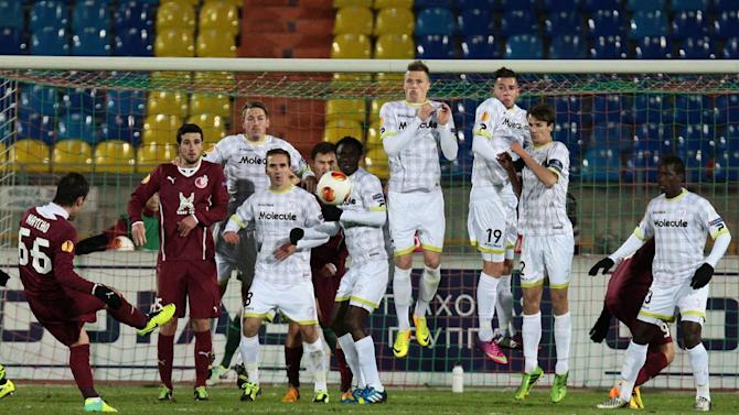 Rubin Kazan's Bebras Natcho, left, takes a free kick as Zulte Waregem players defend during their Europa League Group D soccer match in Kazan, Russia, Thursday, Oct. 3, 2013