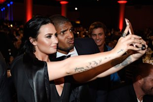 BEVERLY HILLS, CALIFORNIA - APRIL 02: Honoree Demi Lovato (L) and NFL player Michael Sam take a selfie during the 27th Annual GLAAD Media Awards at t...