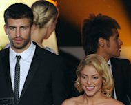 Barcelona defender Gerard Pique (L) arrives with his companion, Colombian singer Shakira (R), on January 9, 2012 for the FIFA Ballon d'Or award at the Kongresshaus in Zurich. Pique irked much the world's media Friday by announcing his girlfriend Shakira had given birth -- but then revealing it was a prank
