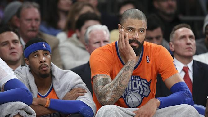 New York Knicks center Tyson Chandler, right, and guard Toure' Murry watch during the second half of Knicks' NBA basketball game against the Oklahoma City Thunder at Madison Square Garden, Wednesday, Dec. 25, 2013, in New York. The Thunder won 123-94
