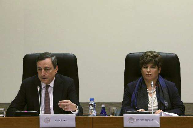 Governor of Central Bank of Cyprus Georghadji and European Central Bank (ECB) President Draghi address a news conference following the ECB Governing Council meeting in Nicosia