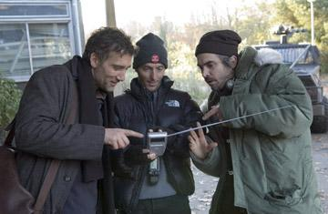 Clive Owen , director of photography Emmanuel Lubezki and director Alfonso Cuaron on the set of Universal Pictures' Children of Men