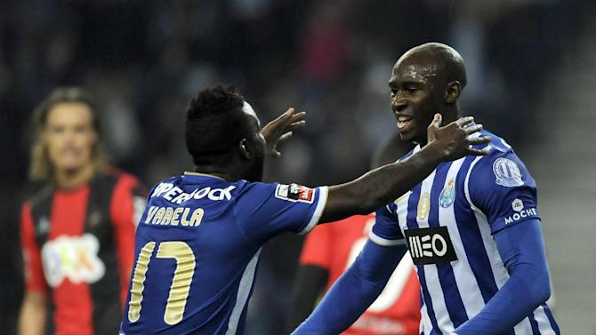 FC Porto's Eliaquim Mangala, from France, celebrates with Silvestre Varela, left, after scoring the opening goal against Olhanense in a Portuguese League soccer match at the Dragao Stadium in Porto, Portugal, Friday, Dec. 20, 2013