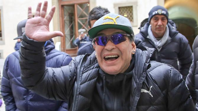 Argentinian soccer legend Maradona waves as he arrives to take part at the Italian soccer Hall of Fame 2017 event in Florence