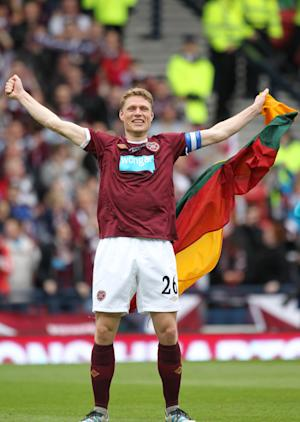 Marius Zaliukas scored from the spot in the 90th minute to earn Hearts a draw
