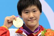 China's Ye Shiwen displays her gold medal after her stunning 400m individual medley swim at the London 2012 Olympics on July 28. The sixteen-year-old swimming prodigy categorically denied doping on Monday after British media raised suspicions about her world record-breaking start to the London Olympics