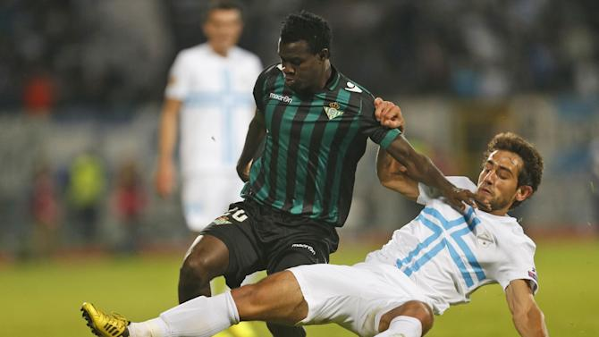 Betis' Nosa, left, is challenged by Rijeka's Mate Males during their group I Europa League first round second leg soccer match, at Kantrida stadium in Rijeka, Croatia, Thursday, Oct. 3, 2013