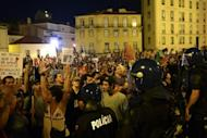 Riot police oficers hold back protesters duing a demonstration in front of parliament in Lisbon. Mass protests in Spain and Portugal, against ever tougher austerity measures, have ramped up the pressure on Iberian governments struggling to avoid international bailouts.